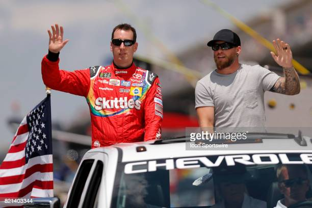 Pole sitter Kyle Busch Joe Gibbs Racing Toyota Camry and Brantley Gilnert Big Machine take a ride around the track prior to the start of the NASCAR...
