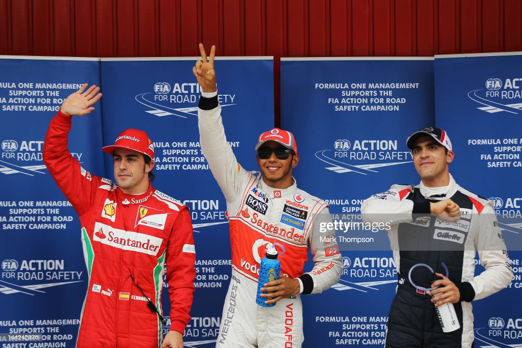 Pole sitter Lewis Hamilton (C) of Great Britain and McLaren celebrates in parc ferme with second placed Pastor Maldonado (R) of Venezuela and Williams and third placed Fernando Alonso (L) of Spain and Ferrari following qualifying for the Spanish Formula One Grand Prix at the Circuit de Catalunya on May 12, 2012 in Barcelona, Spain.