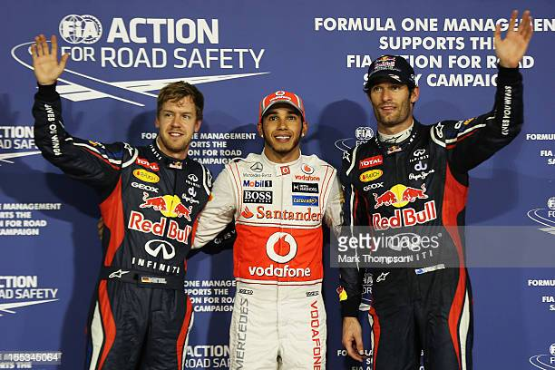 Pole sitter Lewis Hamilton of Great Britain and McLaren celebrates with second placed Mark Webber of Australia and Red Bull Racing and third placed...