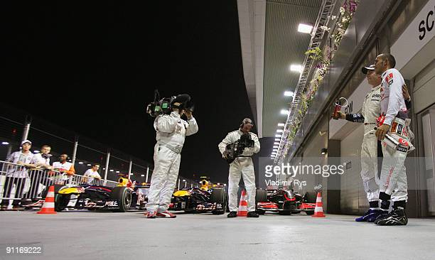 Pole sitter Lewis Hamilton of Great Britain and McLaren Mercedes celebrates with third placed Nico Rosberg of Germany and Williams in parc ferme...