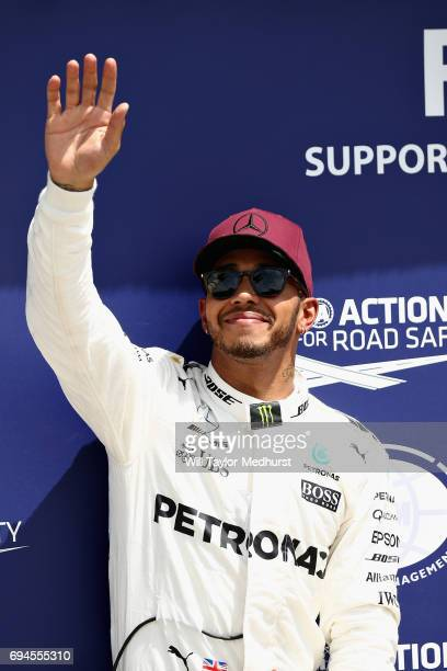 Pole sitter Lewis Hamilton of Great Britain and Mercedes GP waves to the crowd from parc ferme during qualifying for the Canadian Formula One Grand...