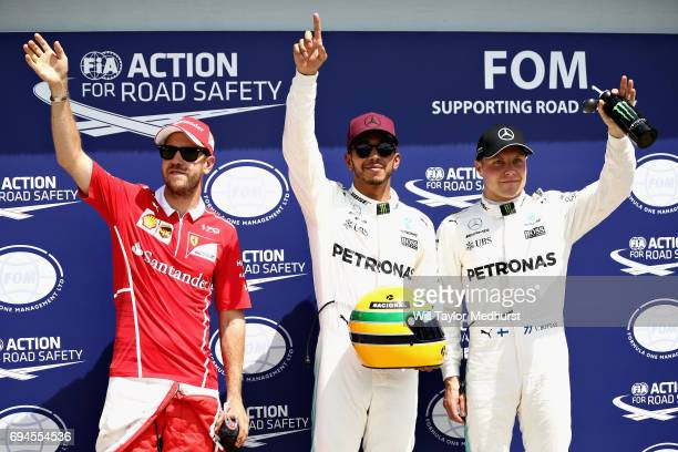 Pole sitter Lewis Hamilton of Great Britain and Mercedes GP with second placed qualifier Sebastian Vettel of Germany and Ferrari and third placed...