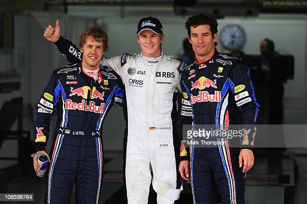 Pole sitter Nico Huelkenberg of Germany and Williams celebrates in parc ferme with second placed Sebastian Vettel of Germany and Red Bull Racing and...