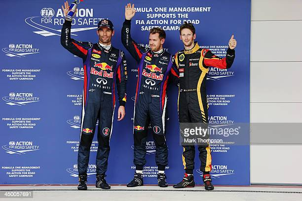 Pole sitter Sebastian Vettel of Germany and Infiniti Red Bull Racing celebrates in parc ferme with second placed Mark Webber of Australia and...