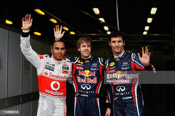Pole sitter Sebastian Vettel of Germany and Red Bull Racing celebrates in parc ferme with second placed Lewis Hamilton of Great Britain and McLaren...
