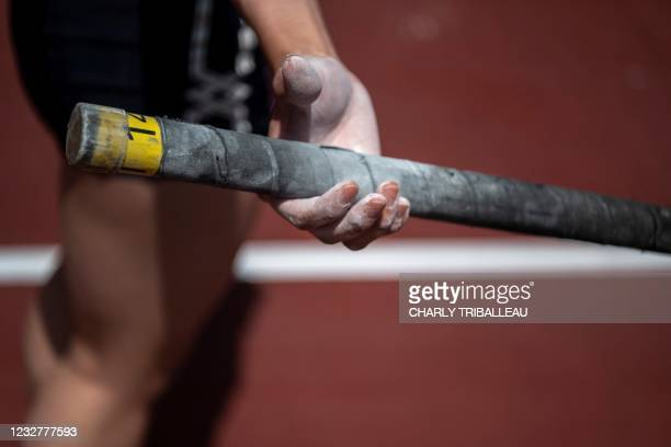 Pole vault athlete prepares to compete during an athletics test event for the 2020 Tokyo Olympics at the National Stadium in Tokyo on May 9, 2021.