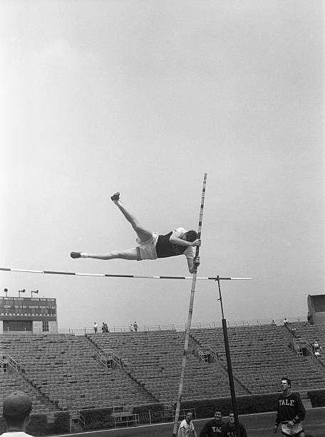 Pole vaulter in air