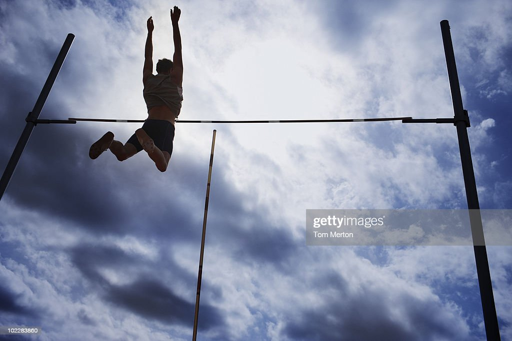 Pole vaulter in mid-air : Stock Photo