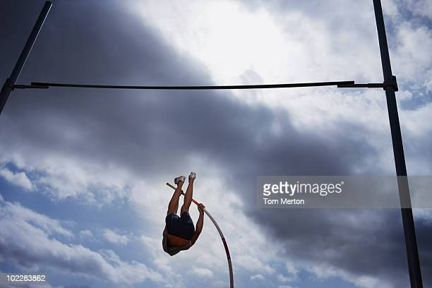 Pole vaulter in mid-air