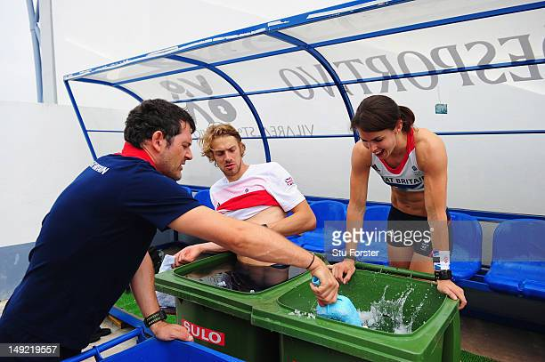 Pole Vaulter Kate Dennison and long jumper Chris Tomlinson take an ice bath after their training sessions during the Team GB Track and Field...