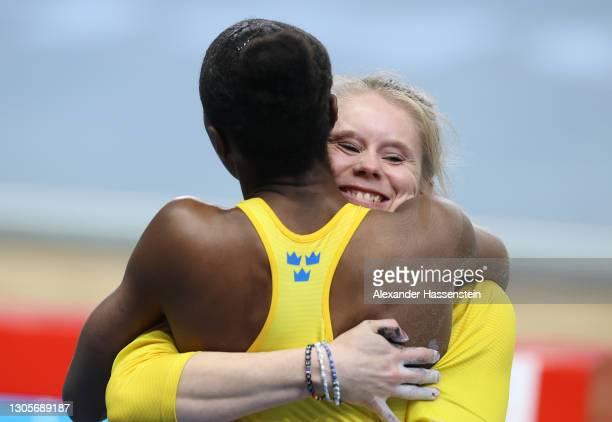 Pole Vaulter Michaela Meijer of Sweden congratulates Khaddi Sagnia of Sweden on her bronze medal following the Women's Long Jump final during the...