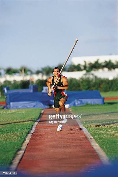 Pole vaulter running with pole