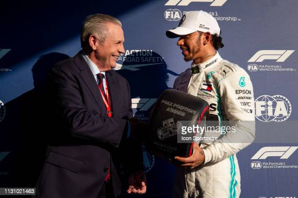 Pole winner MercedesAMG Petronas Motorsport driver Lewis Hamilton accepts the pole trophy from ex F1 champion Alan Jones at The Australian Formula...