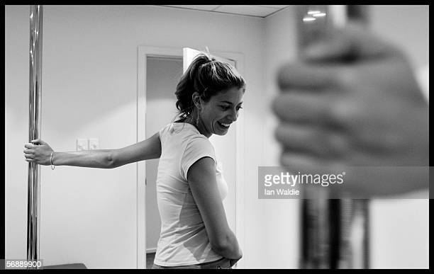 Poledancing student Heather Gidley performs moves during a poledancing lesson February 13 2006 in Sydney Australia Poledancing is becoming a popular...