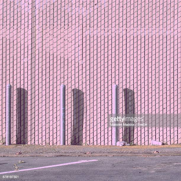 Poles Against Pink Wall