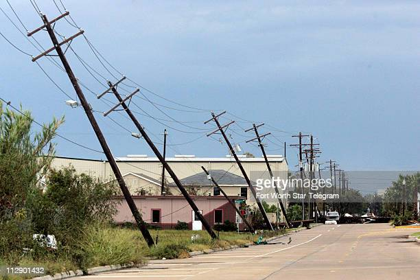 Poles holding up power lines were nearly blown to the ground near Justice Center on Galveston Island in Texas on Sunday September 14 after Hurricane...