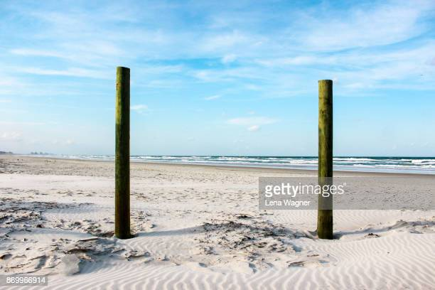 Poles On Sandy Beach with Ocean View
