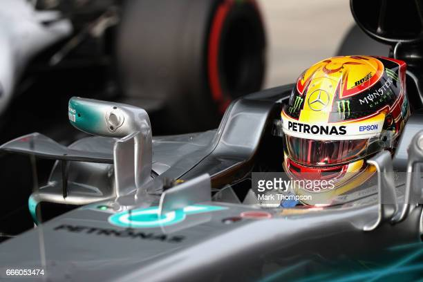 Polesitter Lewis Hamilton of Great Britain and Mercedes GP climbs out of his car in parc ferme during qualifying for the Formula One Grand Prix of...