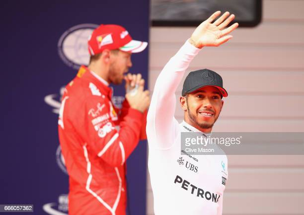 Polesitter Lewis Hamilton of Great Britain and Mercedes GP waves to the crowd in parc ferme during qualifying for the Formula One Grand Prix of China...