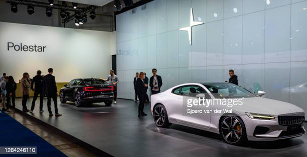 Polestar 1 twodoor hybrid sports car coupe in white and Polestar 2 electric car in black on display at Brussels Expo on January 9 2017 in Brussels...