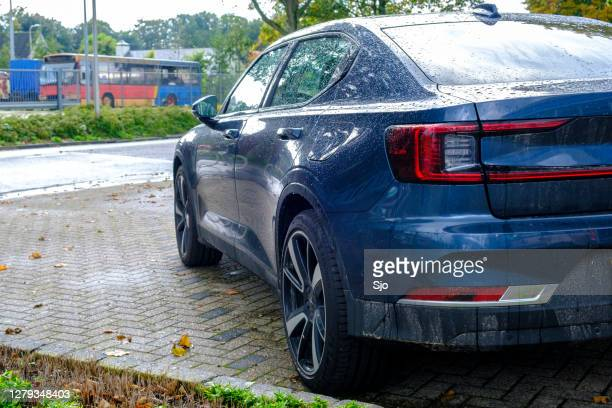 """polestar 2 all-electric fastback car rear view  parked in front of a dealership - """"sjoerd van der wal"""" or """"sjo"""" stock pictures, royalty-free photos & images"""