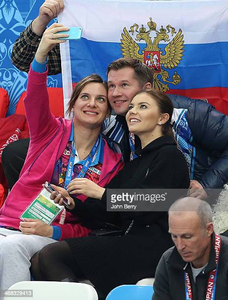 Polevaulter Yelena Isinbayeva gymnast Alexei Nemov and rhythmic gymnast Alina Kabayeva pose for a picture during the Short Track events on day 3 of...