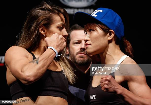 Poliana Botelho of Brazil and Syuri Kondo of Japan face off during during the UFC Fight Night weighin at Movistar Arena on May 18 2018 in Santiago...