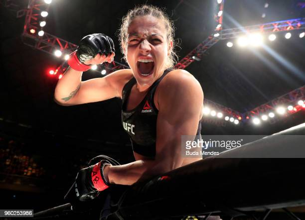 Poliana Botelho of Brazil celebrates after knocking out Syuri Kondo in their women's strawweight bout during the UFC Fight Night event at Movistar...