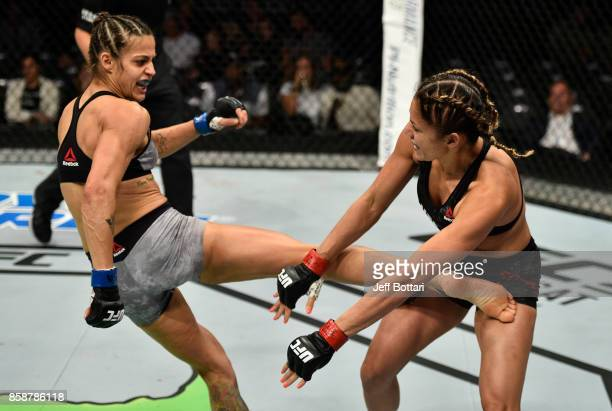 Poliana Botelho of Brazil kicks Pearl Gonzalez in their womens strawweight bout during the UFC 216 event inside TMobile Arena on October 7 2017 in...