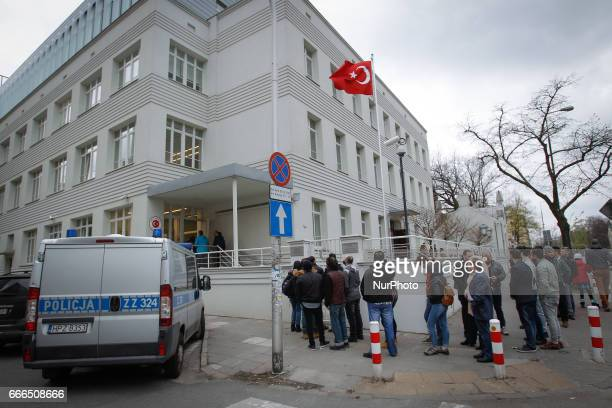 A polic van is seen outside the Turkish embassy in Warsaw on 9 April 2017 while voters wait in line to take part in the consitutional referendum A...