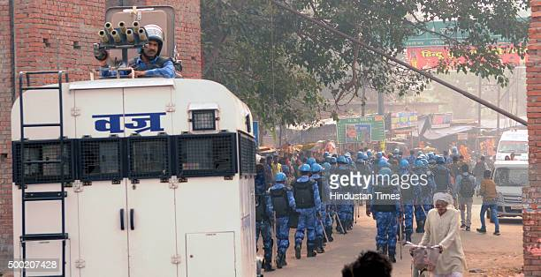 Police Action Force personnel being deployed to ward of any untoward incident on the 23rd anniversary of the demolition of the Babri Masjid on...