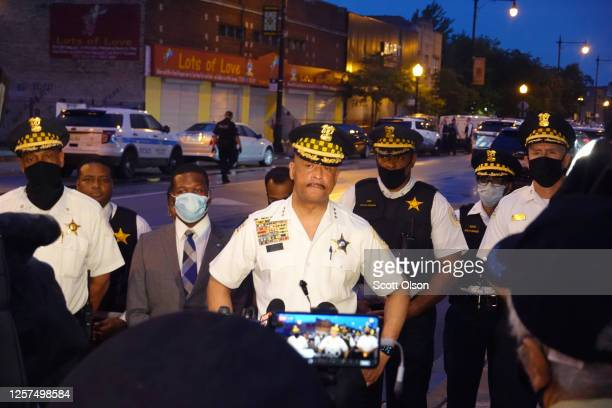 Police address the media at the scene of a shooting in the Auburn Gresham neighborhood on July 21, 2020 in Chicago, Illinois. At least 14 people were...