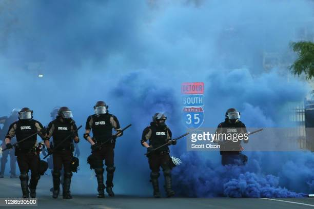 Police advance on demonstrators who are protesting the killing of George Floyd on May 30 2020 in Minneapolis Minnesota Former Minneapolis police...