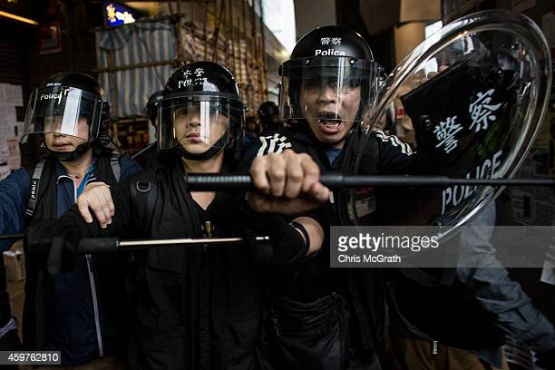 Police advance on prodemocracy protesters at the Admiralty MTR station on December 1 2014 in Hong Kong Leaders from the Federation of Students called...