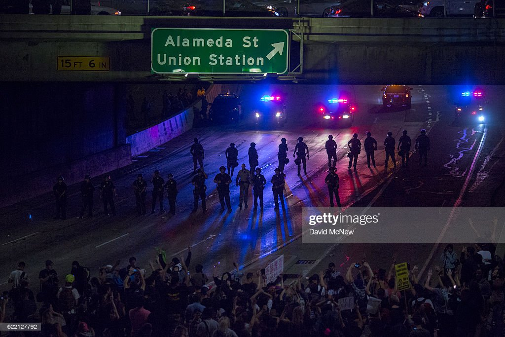 Police advance on protesters who shut down the 101 freeway in opposition to the upset election of Republican Donald Trump over Democrat Hillary Clinton in the race for President of the United States on November 9 2016 in Los Angeles, California, United States.