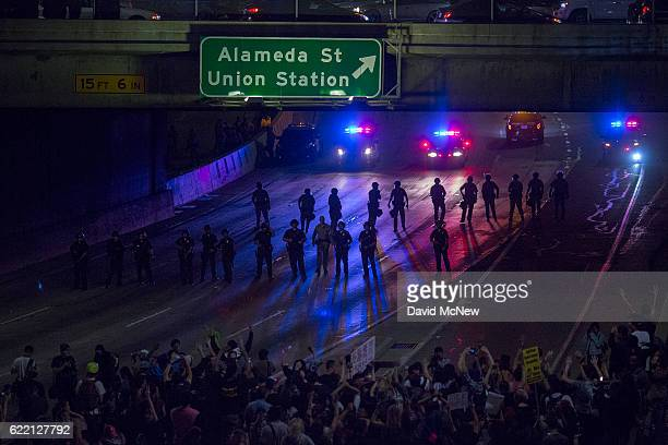 Police advance on protesters who shut down the 101 freeway in opposition to the upset election of Republican Donald Trump over Democrat Hillary...