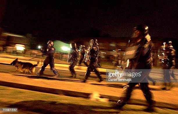 Police advance their lines during the fourth night of sporadic rioting in Macquarie Fields on February 28, 2005 in Sydney, Australia. Tensions were...