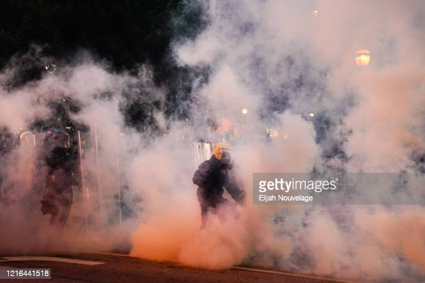 Police advance through a cloud of tear gas during a protest in response to the police killing of George Floyd on May 30 2020 in Atlanta Georgia...