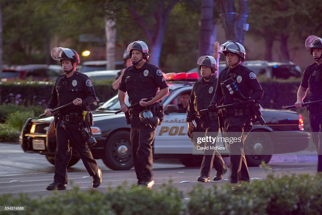 Police advance to make possible mass arrests after declaring an unlawful assembly following a campaign rally by presumptive GOP presidential candidate Donald Trump at the Anaheim Convention Center earlier in the day on May 25, 2016 in Anaheim, California. Previous visits by the candidate to Orange County have sparked protests that resulted in some arrests. The presidential candidates are campaigning in Southern California for the June 7 California primary.