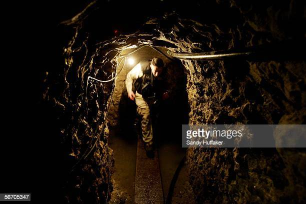 Police agent with US Immigration and Customs Enforcement stands guard in a drug tunnel found along the Mexico/USA Border at a warehouse January 30...