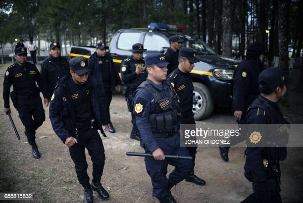 Police agents are pictured before the operation to rescue the four hostages kept held by inmates at the Stage II Male Juvenile Detention Center in...