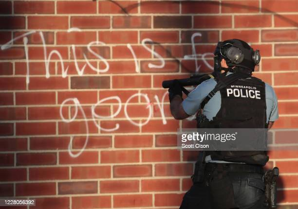 Police aim a tear gas gun during a protest on May 28, 2020 in St. Paul, Minnesota. Today marks the third day of ongoing protests after the police...