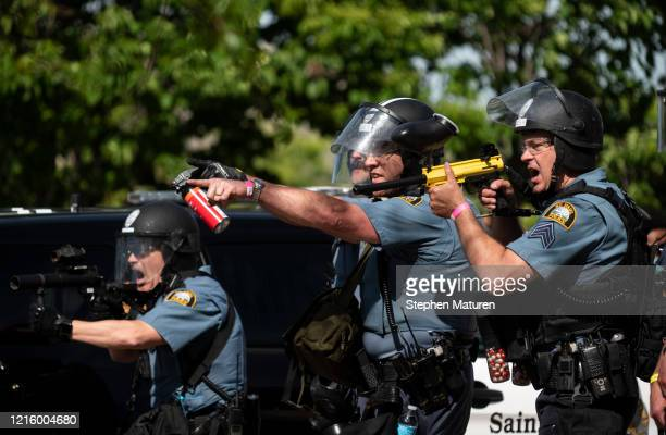 Police aim their weapons at protesters in the parking lot of a Target store on May 28 2020 in St Paul Minnesota Police and protesters continued to...