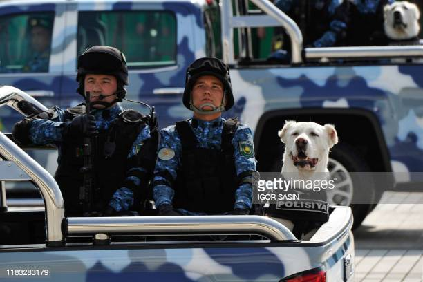Police alabai shepherd dogs are seen riding in trucks during a military parade in central Ashgabat on September 27 on the 28th anniversary of...