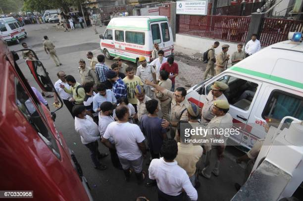 Police along with doctors' team carry bodies of LED company workers through Crane and transfer to the ambulance on April 19 2017 in Noida India...