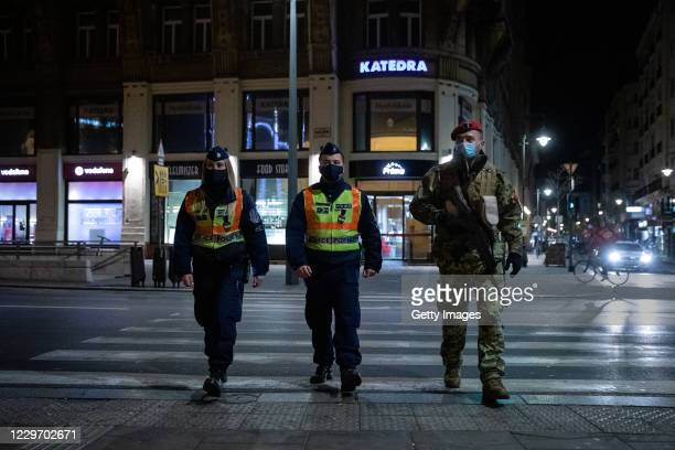 Police and a soldier patrol the streets during the night curfew on November 20, 2020 in Budapest, Hungary. This weekend Hungary will receive the...