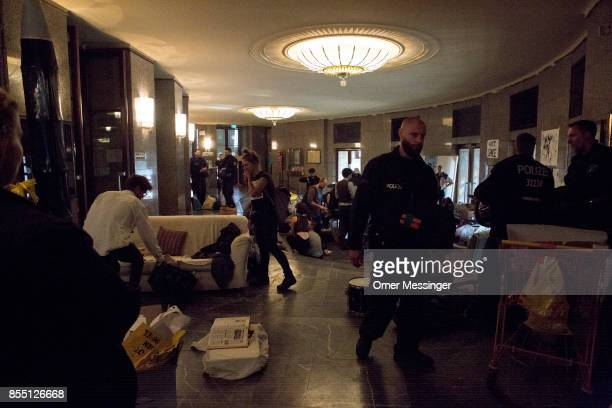 Police and activists are seen inside the Volksbuehne theater during negotiations to end the occupation of parts of the theater by activists on...
