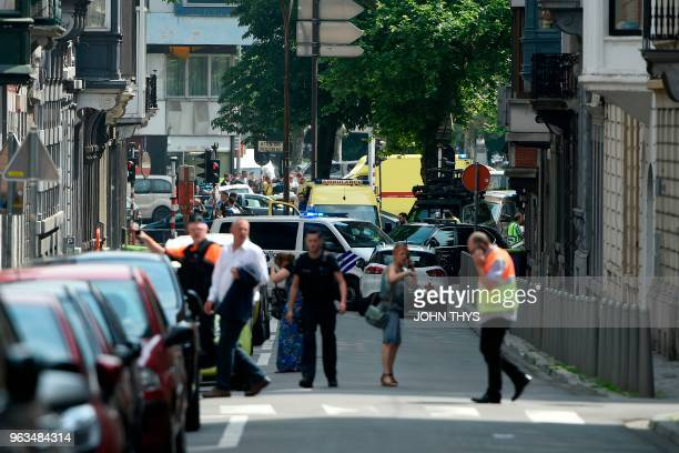 Police and ambulance are seen at the site after a gunman killed two female police officers and a man in a parked car before he was shot dead by...