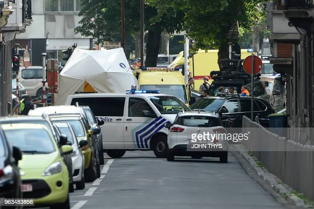 TOPSHOT Police and ambulance are seen at the site where a gunman killed two female police officers and a man in a parked before he was shot dead by...