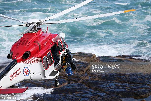 Police and ambulance personnel at the scene on Bondi Beach where a man was injured on September 6 2014 in Sydney Australia
